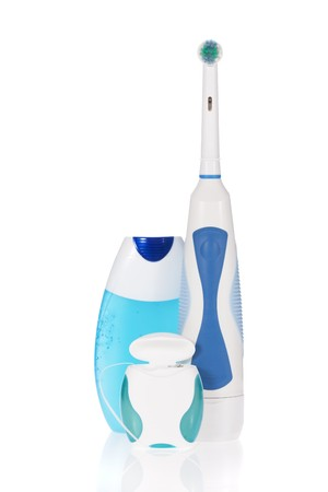 Electric toothbrush, toothpaste and dental floss  isolated on white background Stock Photo