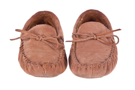 moccasin: Pair of moccasin slippers isolated on white