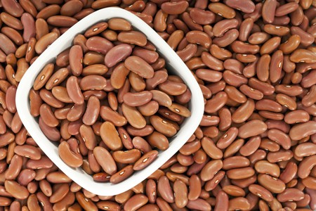 leguminous: Kidney beans or red beans background with a bowl