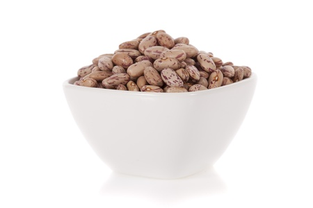 Pinto beans in a bowl isolated on a white background  photo