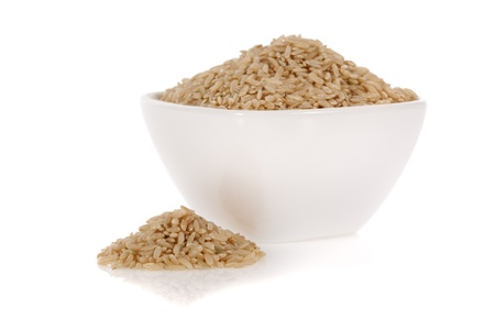 Brown rice in a bowl isolated on a white background  Stock Photo
