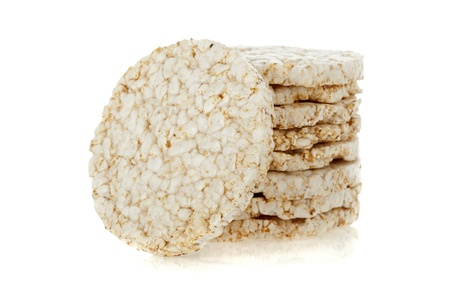 Diet rice cakes pile isolated on white background Stock Photo - 9535921