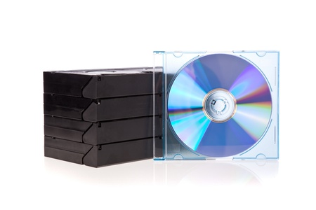 bluray: Old Video Cassette tapes with a DVD disc isolated on white background