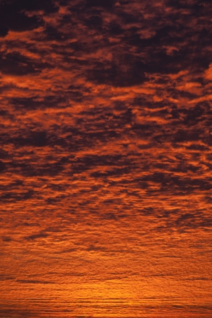 Incredible sunrise or sunset sky with clouds photo