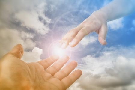 Llegar a Dios Ahorro Mano fot los fieles Foto de archivo - 24748363