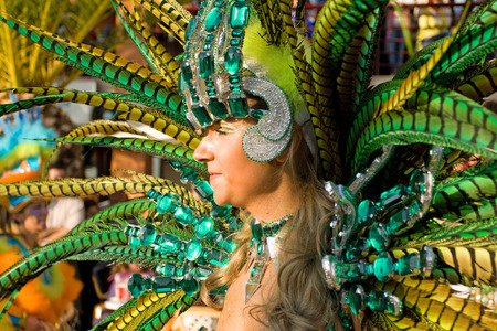 decades: Sesimbra, Portugal - February 12, 2013 - Brazilian Samba dancer called Passista in the Rio de Janeiro style Carnival Parade, organized for decades together with the growing Brazilian community Sesimbra has one of the most important Carnivals in Portugal