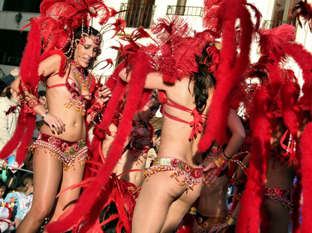 decades: Sesimbra, Portugal - February 12, 2013 - Brazilian Samba dancers called Passistas in the Rio de Janeiro style Carnival Parade, organized for decades together with the growing Brazilian community Sesimbra has one of the most important Carnivals in Portugal