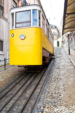 electrico: Lisbon, Portugal - May 26, 2013  Elevador da Gloria, the famous funicular connecting the Restauradores Square to the popular Bairro Alto District  Editorial