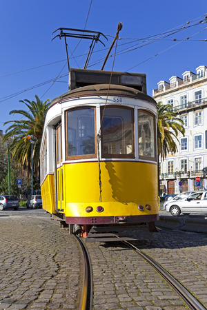 electrico: Iconic 100 year old Lisbon's yellow tram  Lisbon, Portugal  Editorial