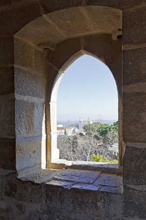 ramparts: Gothic window of a tower of the Sao Jorge  St  George  Castle in Lisbon, Portugal  Editorial