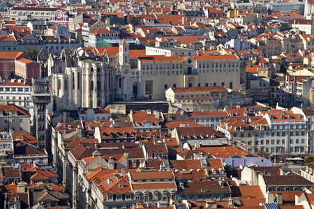 baixa: Carmo Convent, Santa Justa Elevator and rooftops of the historical Baixa District  downtown  of Lisbon, Portugal