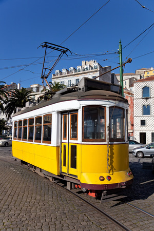 electrico: Iconic 100 year old Lisbon's yellow tram  Lisbon, Portugal  Stock Photo