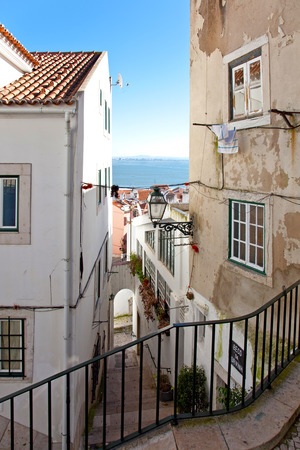 One of the narrow streets of Alfama with the typical cobblestone staircases  Beco da Corvinha   Alfama, Lisbon, Portugal Imagens
