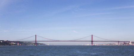 25 de Abril Bridge in Lisbon, Portugal  One of the largest suspension bridges in the world  Connects Lisbon and Almada cities crossing the Tagus River photo