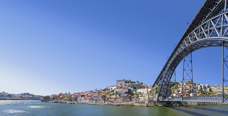 luis: Panorama of the Ribeira District, the Douro River and iconic Dom Luis I bridge in the city of Porto, Portugal  Stock Photo
