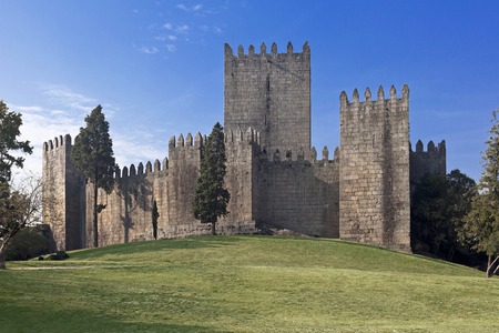 world heritage site: Guimaraes Castle, the most famous  castle in Portugal as it was the birth place of the first Portuguese King and the Portuguese nation  Unesco World Heritage Site  Editorial