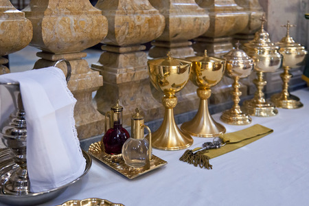 chalices: Mafra, Portugal - September 02, 2013  Rite objects prepared for a Catholic Mass in the Basilica of the Mafra National Palace