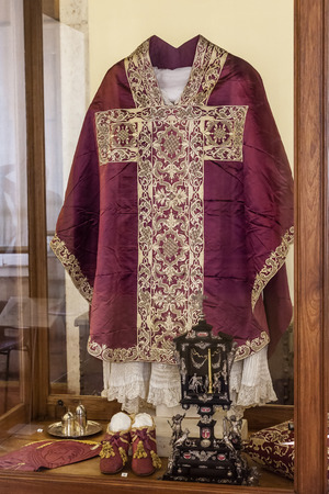 clergy: Mafra, Portugal - September 02, 2013  Clergy vestments - Chasuble, Rochet and Maniple  Mafra National Palace, Portugal