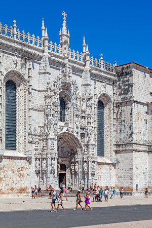 ornated: Lisbon, Portugal. August 24, 2014: The Jeronimos monastery with a view over the heavily ornated south portal. Classified as UNESCO World Heritage it stands as a masterpiece of the Manueline art. Editorial