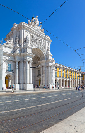 baixa: Lisbon, Portugal. August 31, 2014: Commerce Square, Praca do Comercio or Terreiro do Paco, with the iconic Triumphal Arch  in Lisbon Baixa District (Downtown)