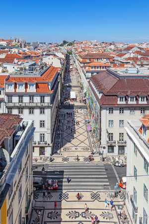 permanently: Lisbon, Portugal. August 31, 2014: Aerial view of the Augusta Street and the Downtown District, known as Baixa. The most cosmopolitan street of the city is permanently full with Lisboans and tourists