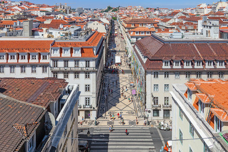 baixa: Lisbon, Portugal. August 31, 2014: Aerial view of the Augusta Street and the Downtown District, known as Baixa. The most cosmopolitan street of the city is permanently full with Lisboans and tourists