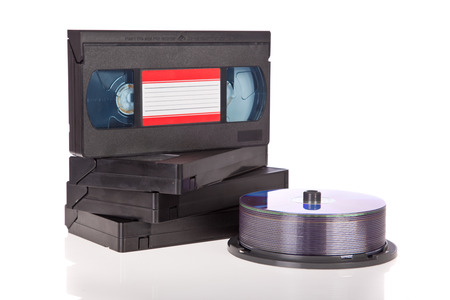 cd player: Old Video Cassette tapes with DVD discs isolated on white  Stock Photo