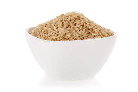 brown rice: Brown rice in a bowl isolated on a white
