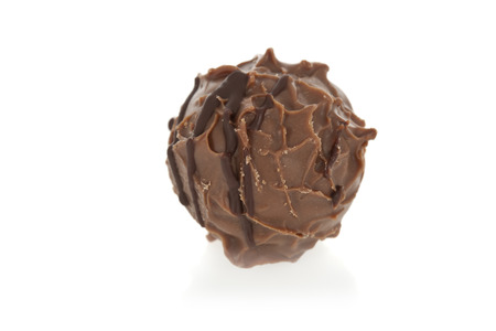 Gourmet chocolate truffle isolated on white  Stock Photo