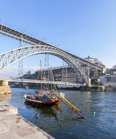 rabelo: The iconic Rabelo Boats, the traditional Port Wine transports, with the Ribeira District and the Dom Luis I Bridge over the Douro River. Porto, Portugal.
