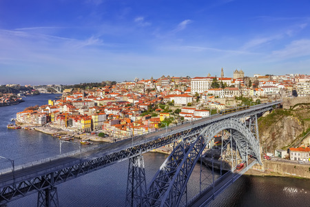 steel arch bridge: View of the iconic Dom Luis I bridge crossing the Douro River, and the historical Ribeira and Se District in the city of Porto, Portugal.