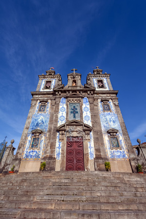 18th century: Santo Ildefonso Church in the city of Porto, Portugal. 18th century Baroque architecture, covered with the typical Portuguese blue tiles called Azulejos.