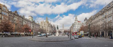 Porto, Portugal. January 5, 2015: The busy Aliados Avenue with the City Hall of Porto located at the top and the BBVA bank on the right