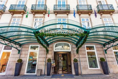 intercontinental: Porto, Portugal. January 5, 2015: Entrance of the Palacio das Cardosas Intercontinental Hotel facing the Aliados Avenue and Liberdade Square. A five stars hotel.