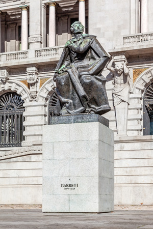 cityhall: Porto, Portugal. January 5, 2015: Statue of Almeida Garrett, one of the most important Portuguese writers of the 19th century (Romantic). Placed in front of Porto City-Hall