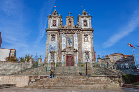 18th century: Porto, Portugal. December 29, 2014: Santo Ildefonso Church. 18th century Baroque architecture, covered with the typical Portuguese blue tiles called Azulejos.