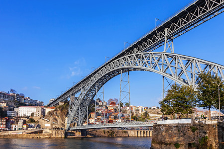 the 19th century: Porto, Portugal. January 5, 2015: The iconic 19th century Dom Luis I bridge seen from the city of Gaia. Unesco World Heritage Site