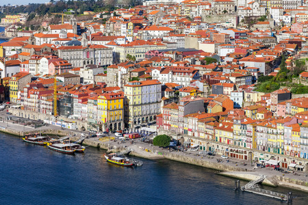 rabelo: Porto, Portugal. January 5, 2015: The typical colorful buildings of the Ribeira District and the Douro River in the city of Porto, Portugal. Unesco World Heritage.