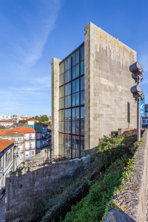 reconstructed: Porto, Portugal. December 29, 2014: Old City-Hall building of the city of Porto - Antiga Casa da Cmara. Reconstructed to serve as a Tourist Office near the Cathedral. Unesco World Heritage.