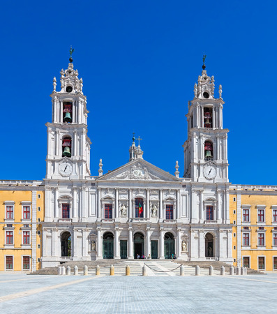 baroque architecture: Mafra, Portugal - September 02, 2014: Tourists stroll in front of the Mafra National Palace, Convent and Basilica. Franciscan Religious Order. Baroque architecture. Editorial