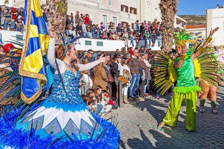 bearer: Sesimbra, Portugal. February 17, 2015: Porta Bandeira (Flag Bearer) and the Mestre Sala (Samba Host), two of the most prestigious characters of the Samba School in the Rio de Janeiro style Carnival Editorial