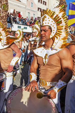percussionist: Sesimbra, Portugal. February 17, 2015: View of the Bateria, the musical section of the Samba School, playing for the dancers in the Brazilian Rio de Janeiro style Carnaval parade. With sound