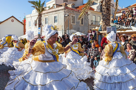 rio: Sesimbra, Portugal. February 17, 2015: The Baianas, one of the most historically important characters of the Rio de Janeiro Brazilian style Carnaval Parade, dancing Samba. Represented by older women.