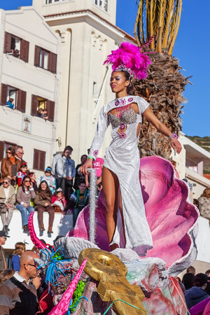 rio: Sesimbra, Portugal. February 17, 2015: Samba dancer performing on top of a Float in the Rio de Janeiro Brazilian style Carnaval Parade.