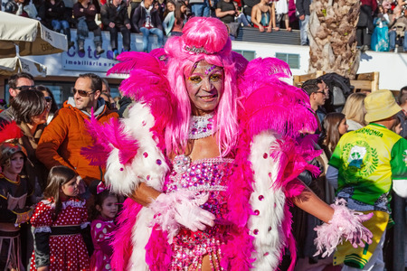 Sesimbra, Portugal. February 17, 2015: Travesti, Transvestite or Drag Queen as a Passista in the Rio de Janeiro Brazilian Samba Carnaval. The Passista is one of the sexiest performers of this event