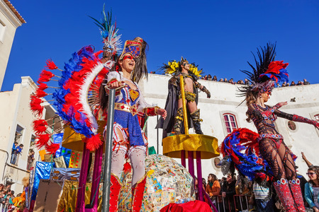 rio: Sesimbra, Portugal. February 17, 2015: Samba dancers performing on top of a Float in the Rio de Janeiro Brazilian style Carnaval Parade.
