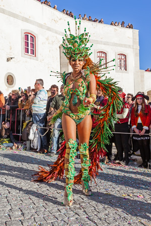 rio: Sesimbra, Portugal. February 17, 2015: Brazilian Samba dancer called Passista in the Rio de Janeiro style Carnaval Parade. The Passista is one of the sexiest performers of this event
