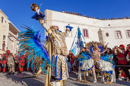 rio: Sesimbra, Portugal. February 17, 2015: Porta Bandeira (Flag Bearer) and the Mestre Sala (Samba Host), two of the most prestigious characters of the Samba School in the Rio de Janeiro style Carnival Editorial