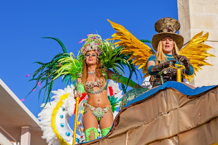 rio: Sesimbra, Portugal. February 17, 2015: Liliana Filipa Antunes (left), a star from the Secret Story Reality Show, performing on top of a Float in the Rio de Janeiro Brazilian style Carnaval Parade.