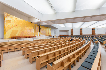 Sanctuary of Fatima, Portugal. Interior of the modern Minor Basilica of Most Holy Trinity with a view over the altar, aisles and pews. Fatima is a major Marian Shrine for pilgrims Editorial